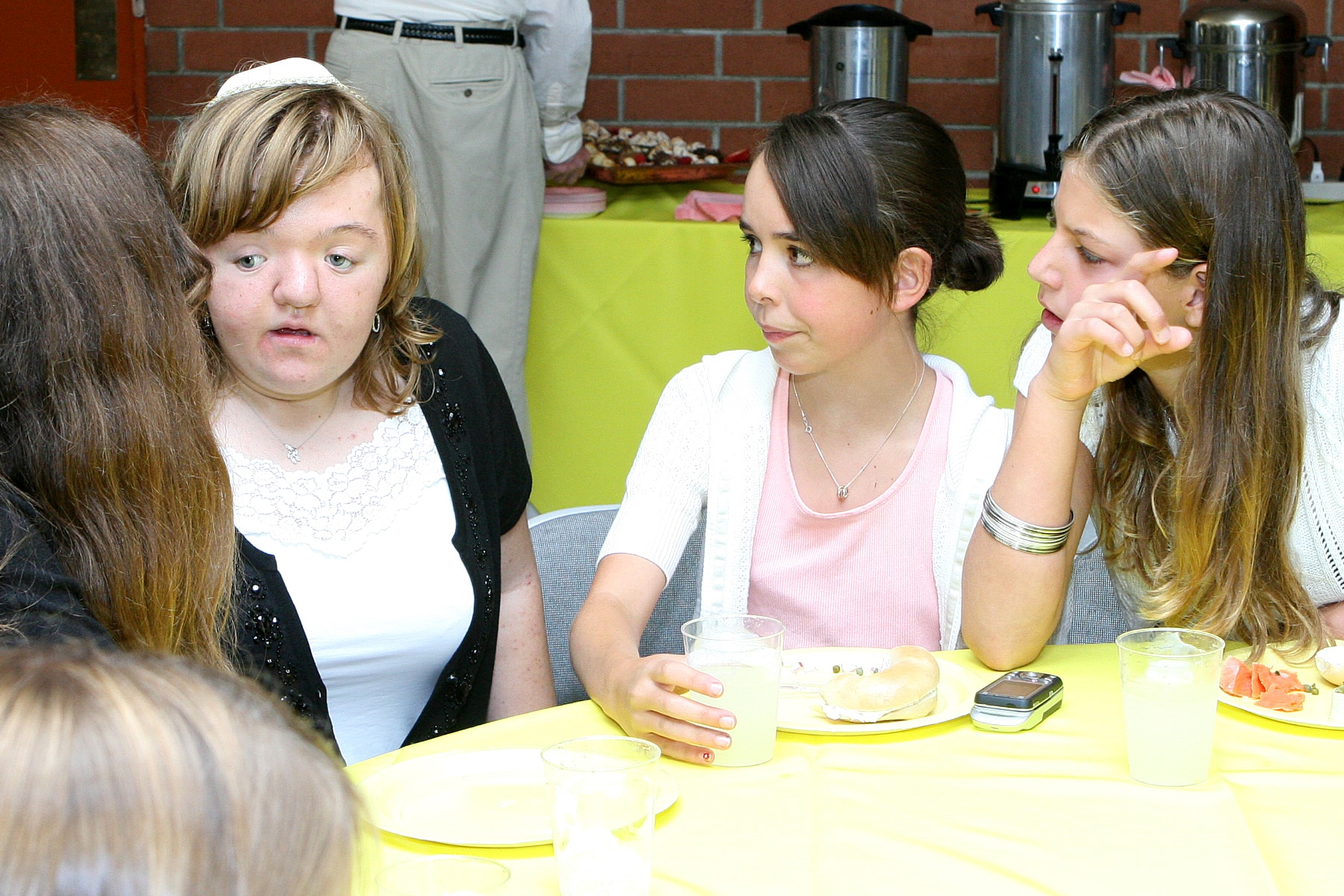 Lili Rachel Smith sitting at lunch with Students