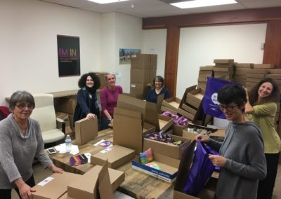 More volunteers packing Beyond Differences backpacks
